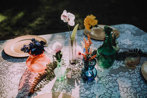 colorful glass centerpieces lace table cloth gold chargers