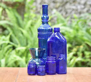 blue glass bottles centerpieces