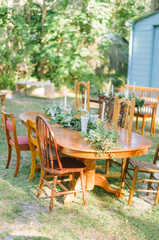 garland, milk glass, succulents, eclectic random wooden tables