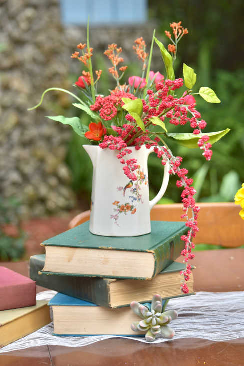 floral vase book centerpiece
