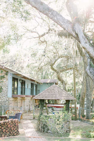 Front and side view of the lodge from the large garden. Wishing well for romantic pictures