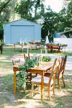 wood tables for reception, garland, milk glass, brass candlesticks, large garden