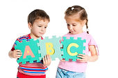Boy and Girl Holding Letters.jpg