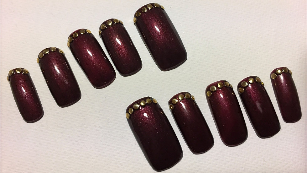 9, brown with gold studs