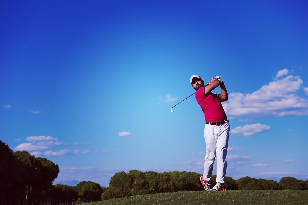 golf player hitting shot with driver on
