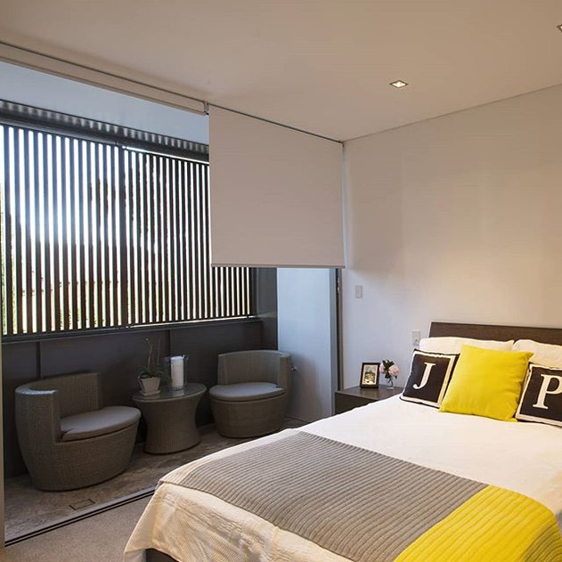 Master bedroom with private courtyard terrace.