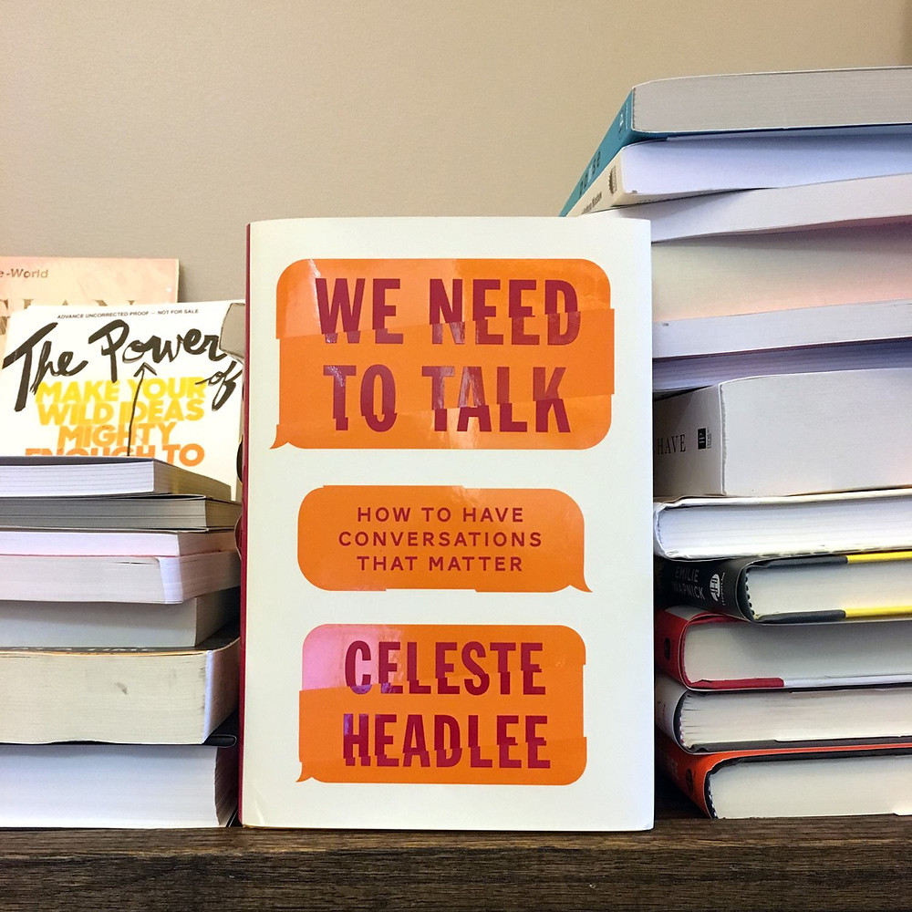 Photo of a book on a shelf titled We Need to Talk by Celeste Headlee
