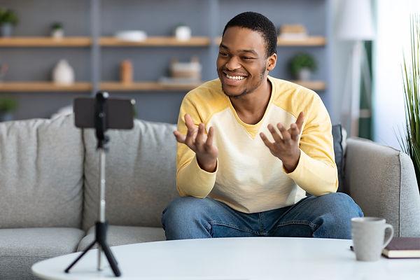 cheerful-african-american-man-influencer-broadcast-MQG4JQK