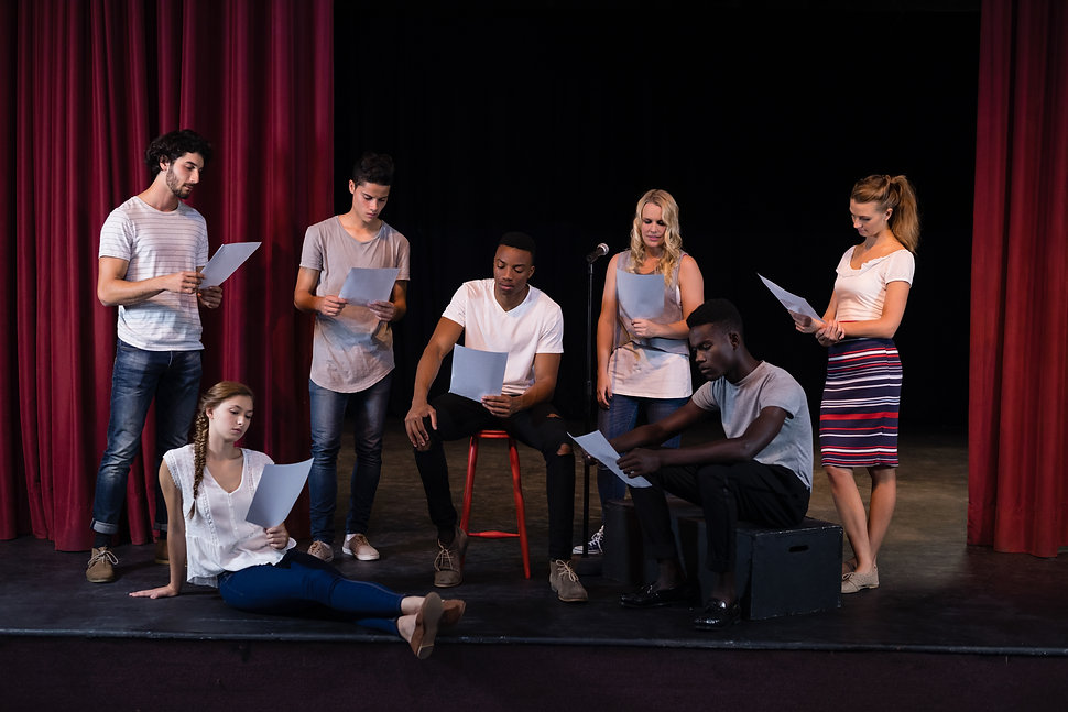 actors-reading-their-scripts-on-stage-K5