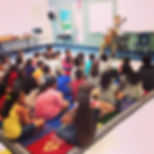 Jase Rylan Brown performing for a classroom of children for an outreach program organized by Guitar San Antonio.