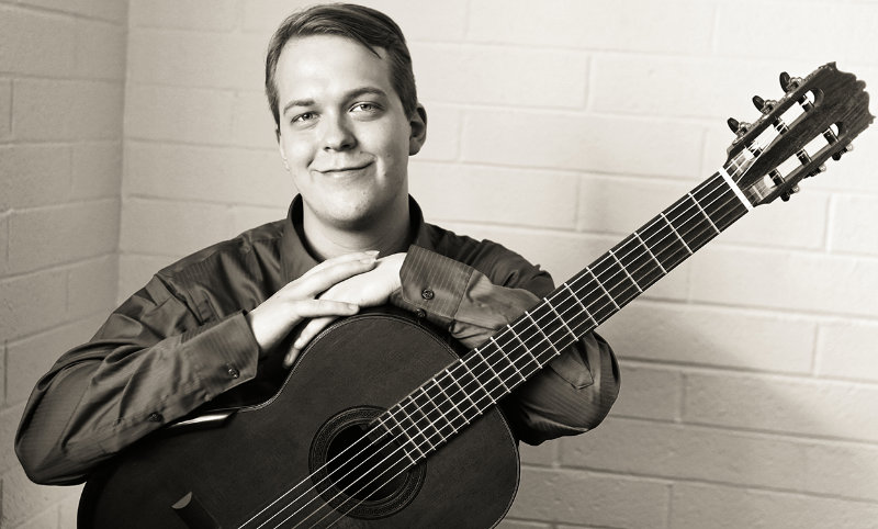 Black and white portrait of classical guitarist Jase Rylan Brown