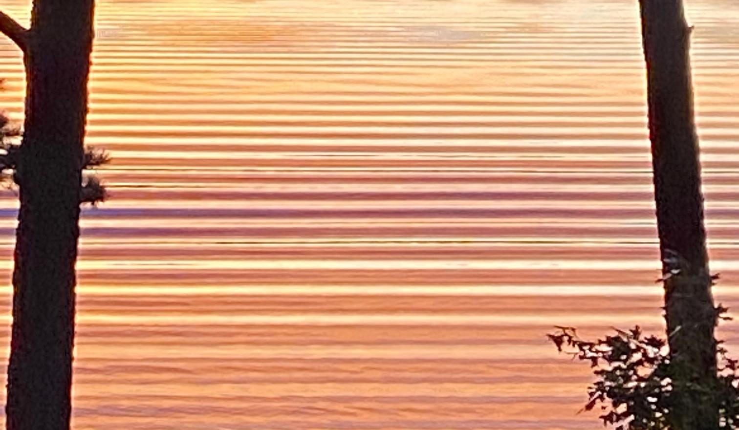 boat wake a sunset