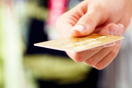 Close-up of credit card in human hand in
