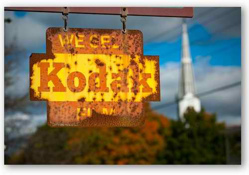 Rusty Kodak sign symbolizing the decline of a company that did not adapt to a new environment.