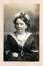 Girl in sweethearts naval uniform