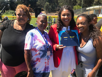 Mayor London Breed and Author Kadija Phillips with K. Angel Careers Book