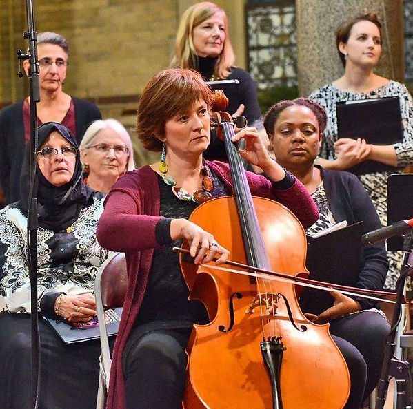 Kath playing cello at a Syracuse Community Choir concert