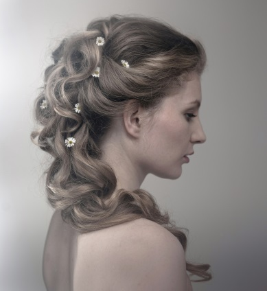 Romantic wedding hair updo daisies.