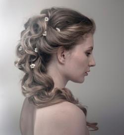 Romantic wedding hair updo daisies.