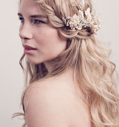 Dewy, flawless skin for summer beach or country wedding. Long lashes and full lips for bridal makeup. Dutch or French plait hairstyle.