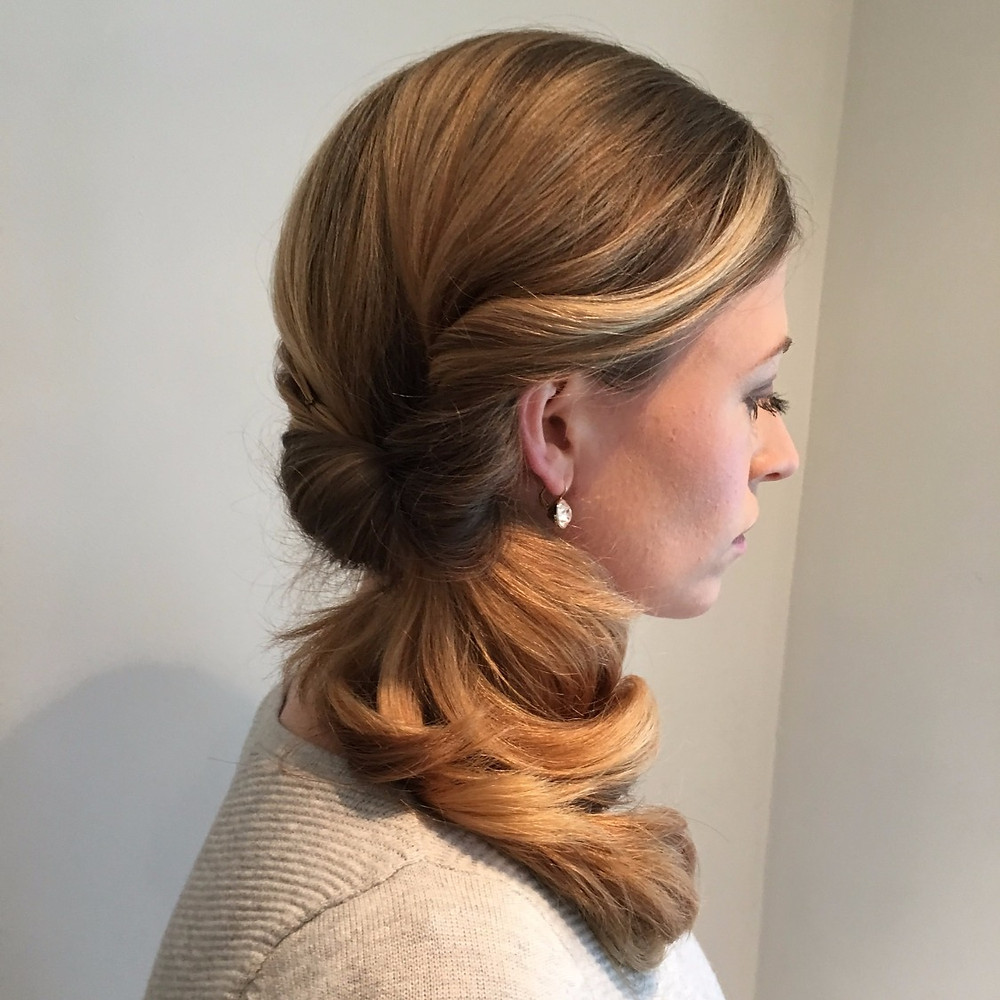 Side ponytail bridal hair looped for a soft and relaxed looked