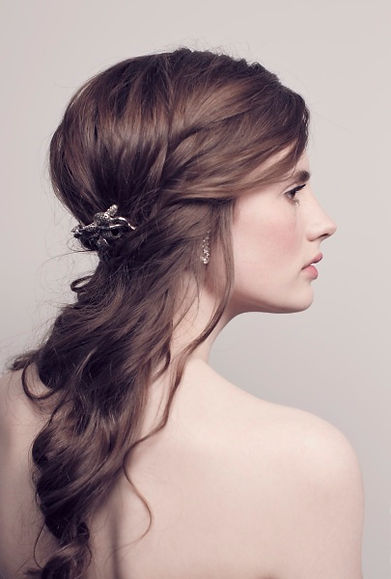 Natural relaxed classic wedding hairstyle for a romantic wedding look.  Flawless, natural makeup with rosey lipstick. Perfect for ideas for a bride or bridesmaid.