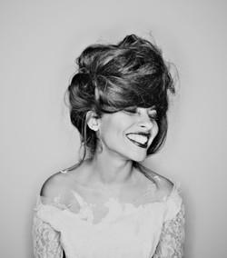Updo bridal hair for wild bride