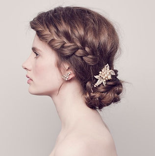 Perfect wedding hairstyle for brides with thick long or mid length hair. Dutch braid and a plaited bun hairstyle suits most brides. Decorate with sparkly vintage pearl headpiece.