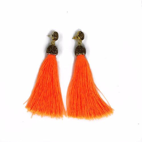 Long gold encrusted neon orange tassel earrings