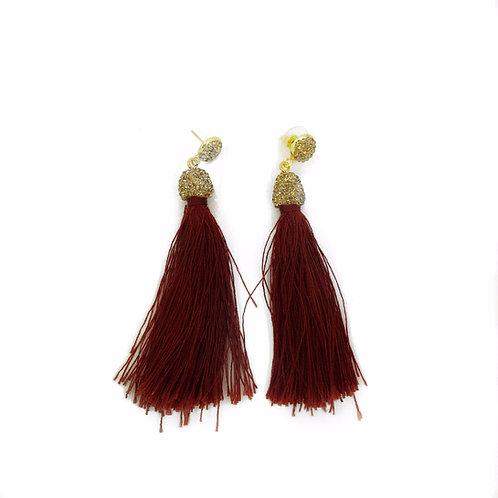 Long gold encrusted merlot tassel earrings