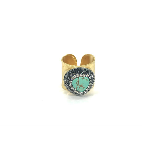 Gold cuff ring with turquoise gemstone