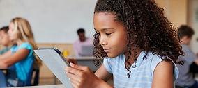 Canva-School-Girl-Using-Tablet-in-Elemen