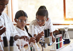 girls-doing-science-experiments-in-class
