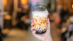 close-up-young-woman-holding-cup-tapioca
