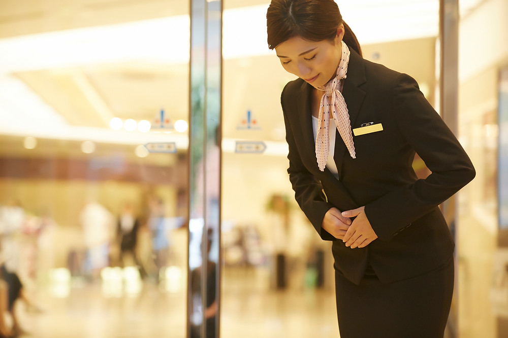 Japanese concierge woman bowing