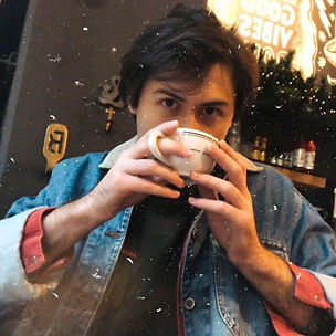 Noah sipping coffee.