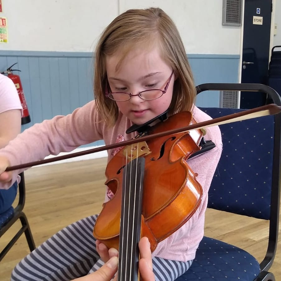 A 9 year old girl playing a violin