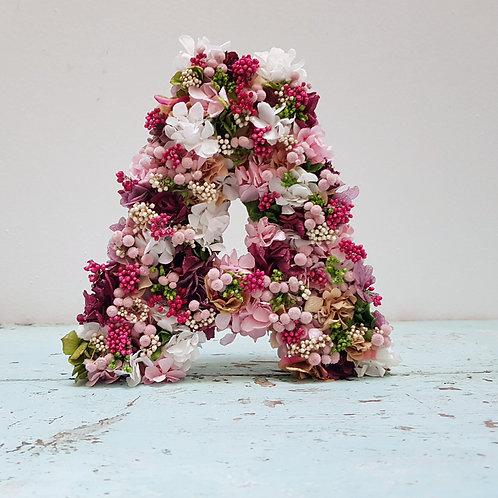 Inicial flor preservada