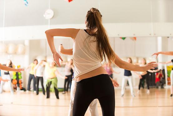 GIRL TAKING A GROUP DANCE CLASS