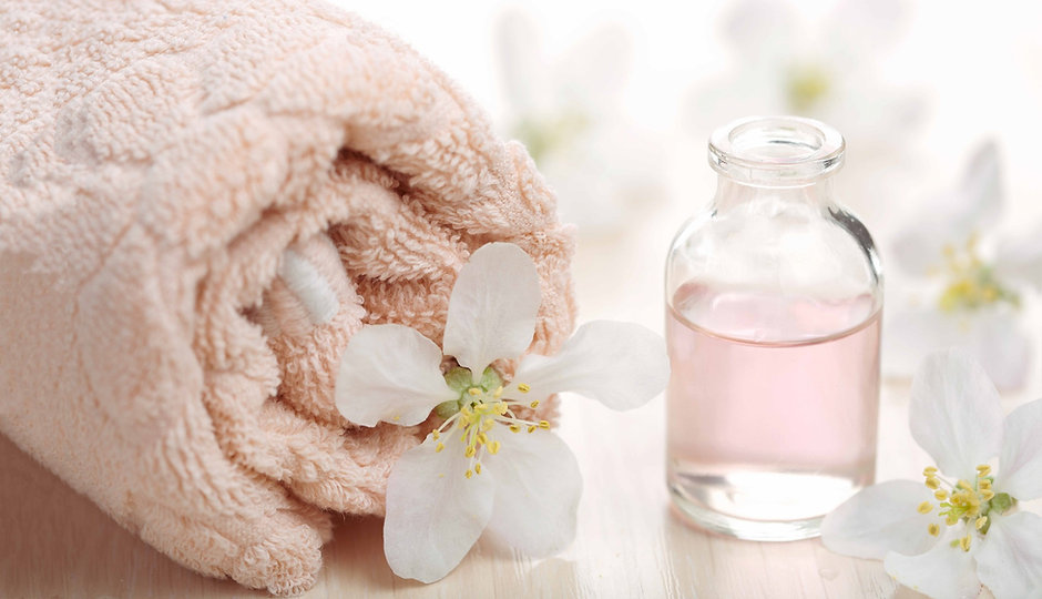 skincare product, towels, flowers, aromatherapy oils