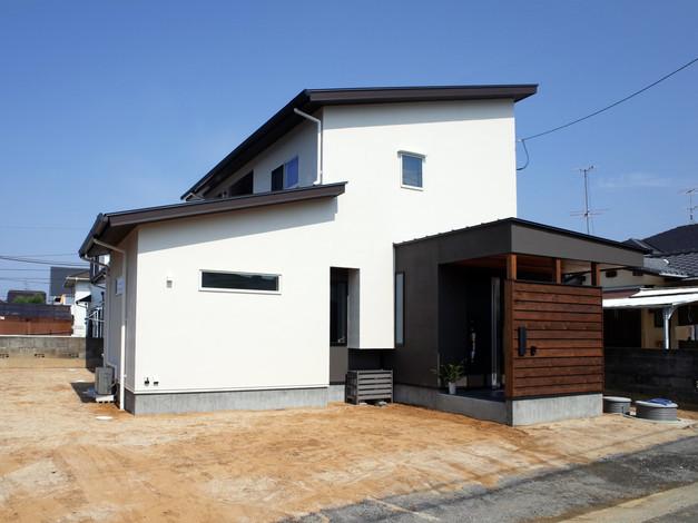 オープンキッチンのあるツナガル回れるコの字型の家