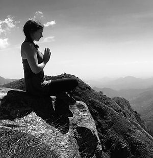 Chrissy Mueller doing yoga on mountain top