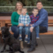 Jay, Kelsee, Jackson, an Lucas Anderson with their dog.