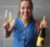 Katie Pekar with her favorite bottle of Chardonnay