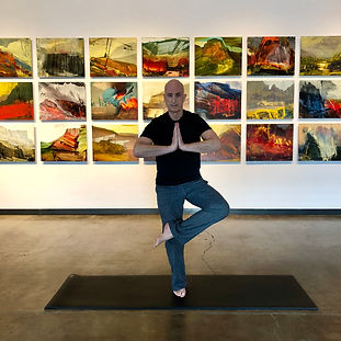 Ron Robinson going yoga in art gallery