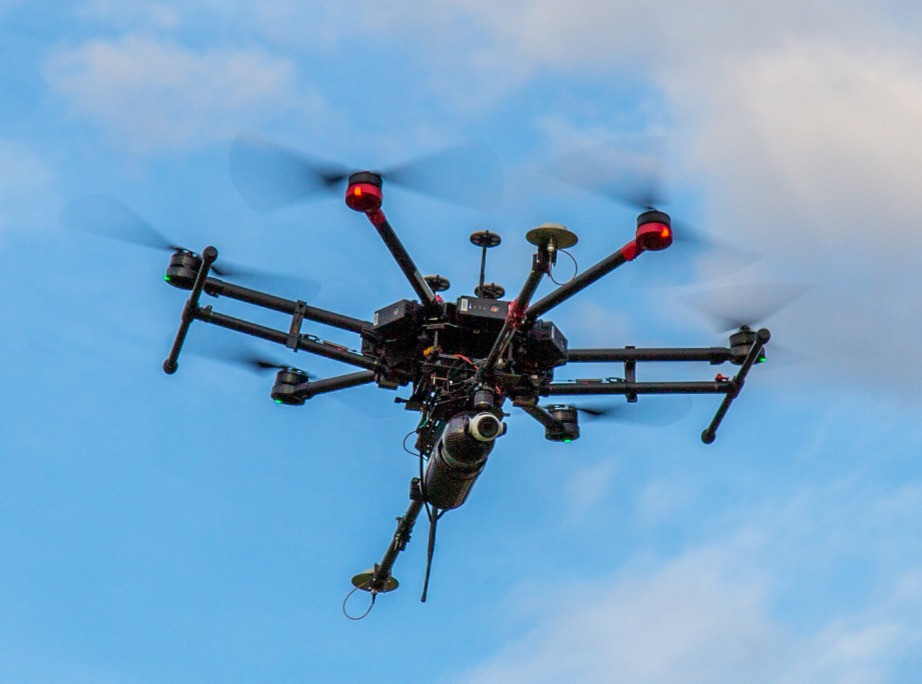 Drone LiDAR system in the air preparing to land