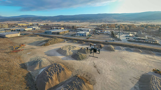 aerial view of a drone mapping stockpiles
