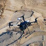 photogrammetry drone flying over stockpiles