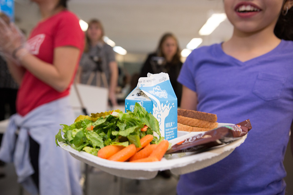 Student holding a school lunch tray