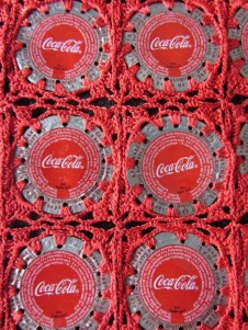 These Coca-Cola bottle caps have been recycled into a beautiful crocheted bag by artisans supported by the 5by20 effort.